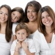 Waist up image of smiling hispanic family with mothers and daughters — Stock Photo