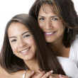 Closeup portrait of smiling hispanic mother and teenage daughter — Stock Photo
