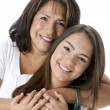 Smiling hispanic mother and teenage daughter — Stock Photo #21367237