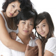 Stock Photo: Smiling asian mother with her two daughters