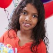 Royalty-Free Stock Photo: Indian little girl celebrating at a birthday party