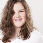 Close up headshot of smiling caucasian teenage girl — Stock Photo #21368321