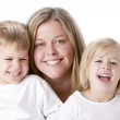 Image of laughing caucasian mother and her children — Stock Photo #21369043