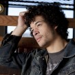 Mixed race adult man with a serious expression on his face as if he is thinking — Stock Photo
