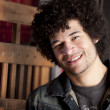 Smiling mixed race young adult man — Stock Photo