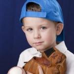 Portrait of little boy wearing baseball cap and holding baseball mitt — Stock Photo