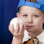 Serious caucasian little boy wearing baseball cap — Stock Photo