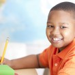 Image of african american little boy studying in school — Stock Photo