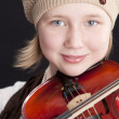 Stock Photo: Close up image of caucasian little girl playing a violin