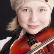 Close up image of caucasian little girl playing a violin - Stock Photo