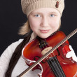 Stock Photo: Image of caucasian little girl playing a violin