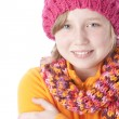 Little girl bundled up in her colorful winter hat and scarf — Stok fotoğraf #21369783