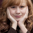 Close up headshot of smiling preteen girl — Стоковая фотография