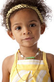 Toddler girl looking at camera with a blank expression — Stock Photo