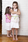 Happy, adorable sisters play hide and seek together — Stock Photo