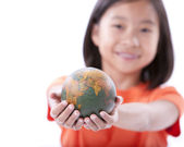 Asian girl holding small globe or earth — Stock Photo