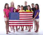 Children of different ethnicities holding an american flag — Stock Photo