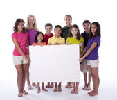 Cute children and teens holding blank sign — Stock Photo