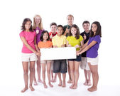 Children and teens holding blank sign with thumbs up — Foto Stock