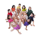 Children of different ethnicities posing in a circle — Stock Photo