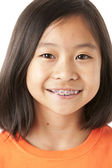 Asian little girl with big smile and braces — Стоковое фото