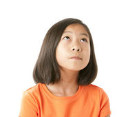 Asian girl looking up in wonder or with hope — Stock Photo
