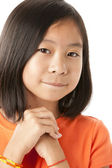 Asian girl looking hopeful — Stock Photo