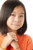Asian girl looking hopeful — Stock Photo