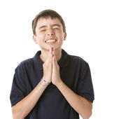 Adolescent boy hoping and praying — Stock Photo