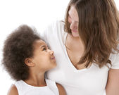 Mother and daughter look affectionately at her daughter — Stock Photo