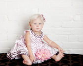 Pretty toddler girl in pink dress — Stock Photo