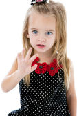 Caucasian little girl holding hand up wave stop — Stock fotografie