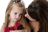 Caucasian young mother comforting her daughter — Stock Photo