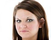Closeup portrait of serious caucasian young woman — Stock Photo