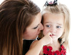 Young mother comforting her daughter — Stock Photo