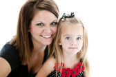 Headshot of laughing mother and daugher — Stock Photo