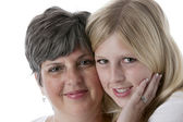 Portrait of smiling caucasian mother and daughter — Stock Photo