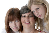 Image of smiling mother and her two daughters — Stock Photo