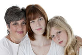 Portrait of smiling mother and two daughters — Stock Photo