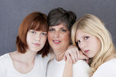Portrait of caucasian mother and her two daughters — Stock Photo