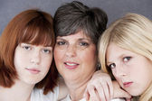 Image of smiling caucasian mother and her two daughters — Stock Photo