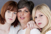 Smiling caucasian mother and her two daughters — Stock Photo