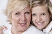 Smiling grandmother and granddaughter — Foto Stock