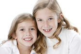 Two caucasian smiling sisters — Stock Photo