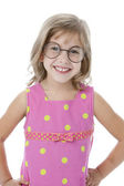 Waist up image of smiling little girl wearing glasses and pink dress — Stock Photo
