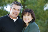 Image of smiling husband and wife in the park — Stock Photo