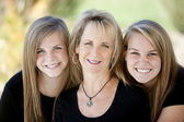 Image of family with mother and her two teenage daughters — Stock Photo