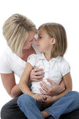 Three quarter length image of mother and daughter — Stock Photo