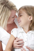Full frame image of mother and daughter affectionately rubbing noses — Stock Photo