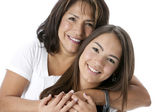 Smiling hispanic mother and teenage daughter — Stock Photo